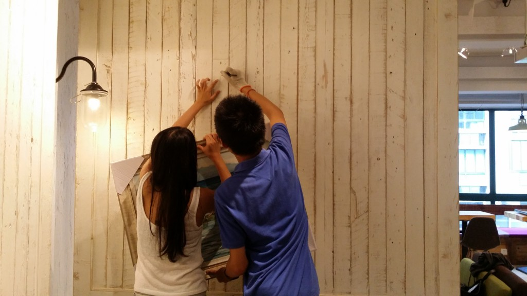 The artists hard at work preparing for the exhibition.