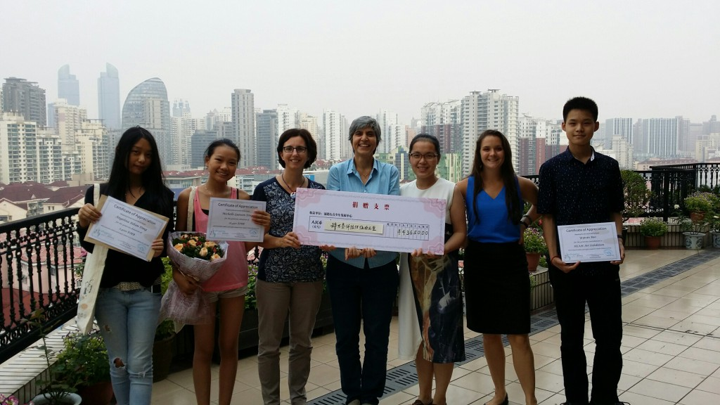 The artists and Stepping Stones staff with funds in hand.