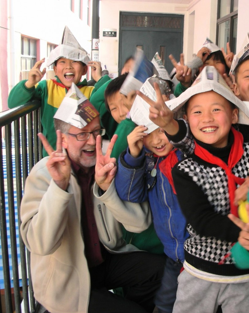 Oliver Pointer & students with paper hats